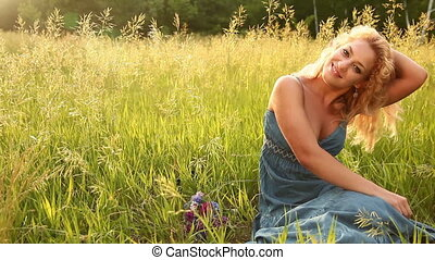 Young adult with flowers sitting - Young adults outdoors