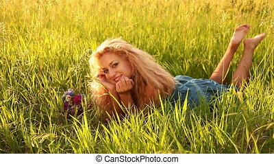 Young adult with flowers lying - Young adults outdoors