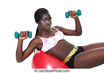 Young female working out weights
