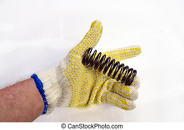 coil spring - Man holding an coil spring in his hand