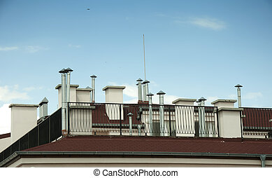 Many Chimneys on rooftop.Blue sky