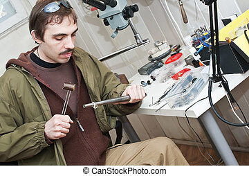 jeweller is working - Male jeweller is working at jeweller's...