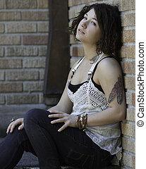 Young woman in alternative attire.