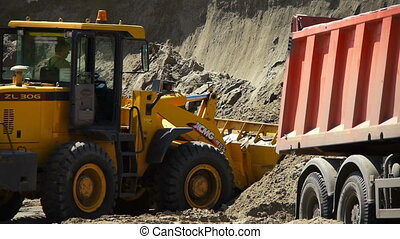 Yellow loader working on a construction site