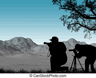 Two photographers - Silhouette of two photographers lined up...
