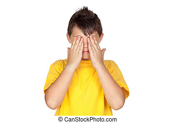 Funny child with yellow t-shirt covering eyes