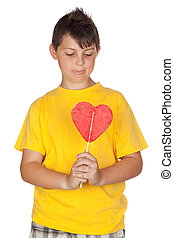Funny child with yellow t-shirt with a big lollipop