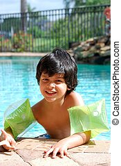 Hispanic boy swimming in the pool