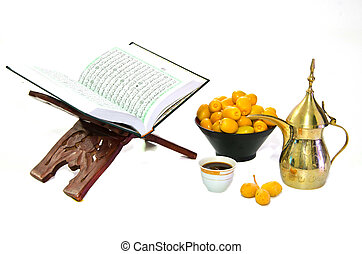 The Holy Quran and Arabic Coffee with date fruit on white...