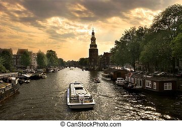 Amsterdam cityscape at evening. - View on city canal (Amstel...