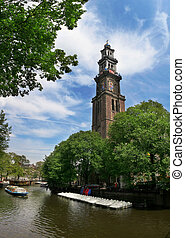 Amstel river and Westerkerk church in Amsterdam.