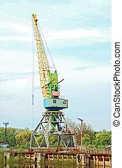 Cargo crane in river harbor