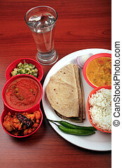 Indian food with chapatti, rice and curries