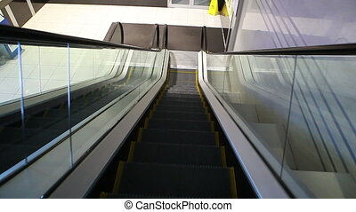 Moving escalator - View of elevator stairway moving...