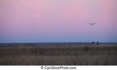 Landing of plane - Airplane landing during twilight