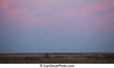 Landing plane - Airplane landing during twilight