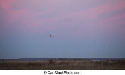 Landing plane - Airplane landing during twilight