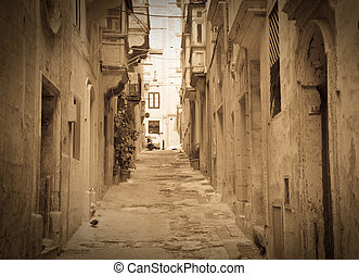 Retro photo of old picturesque street of Valletta. Malta