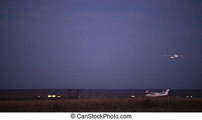 Landing - Airplane landing during twilight