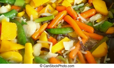 Cooking vegetables - Cooking in oil and stirring various...