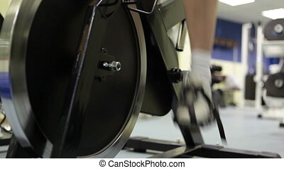 Exercise bike - Close-up of woman riding on the exercise...