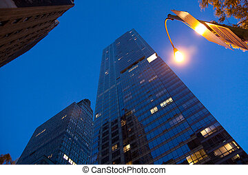 Corporate buildings in perspective with blue sky in the...