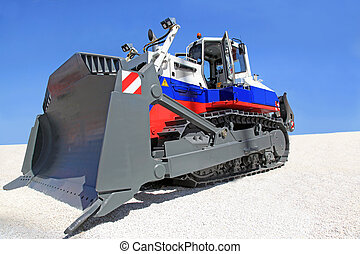 bulldozer - A large  bulldozer at a construction site