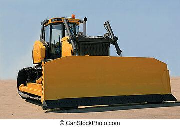 bulldozer - A large yellow bulldozer at a construction site...