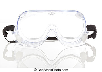 Clear safety glasses against a white background