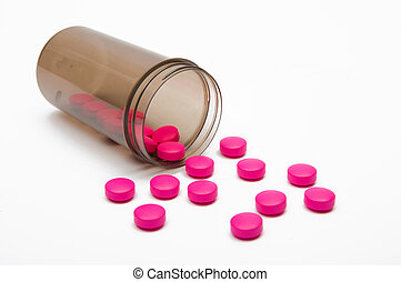 Pink pills - Jar of pink pills against a white background