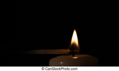 Candle being lit and blown out. - A person lits the candle...