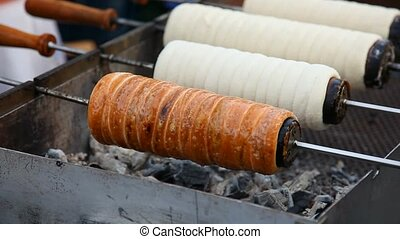 Barbecued chimney cake cooking