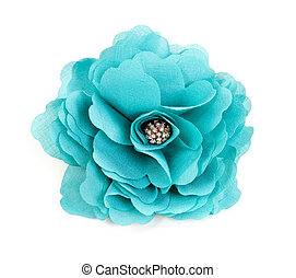 turquoise fabric flower isolated on a white background