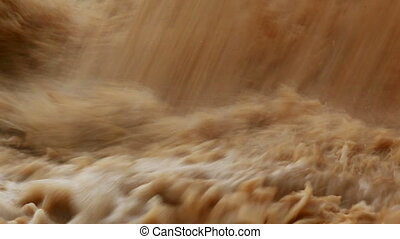 Dirty water - Stream of dirty water pouring into river and...