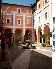 Courtyard with a fountain in the center in Italy