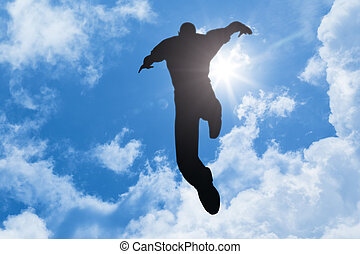 bright sun man jumping