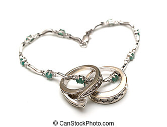 Rings - two golden wedding rings with stones with chainlet