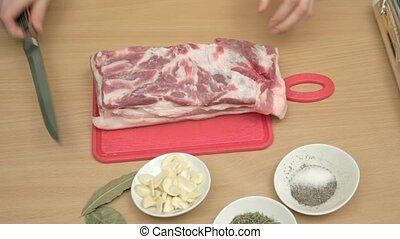 Piercing thick piece of pork with