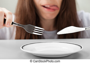 Women hand holding fork and knife - Hungry person hand...