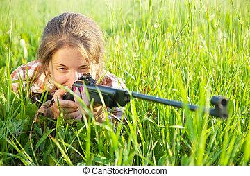 girl  aiming an air rifle