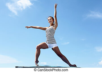 Portrait of a young woman doing exercises