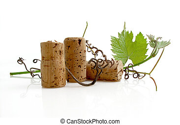 Wine Tasting - Three wine corks with grapevine leaves and...