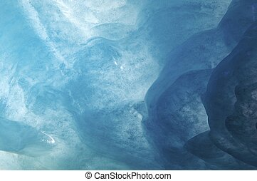 ice - blue background created by the ice cave on the Mer de...