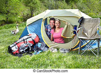 Camping. - Happy young couple with big tent. Camping.