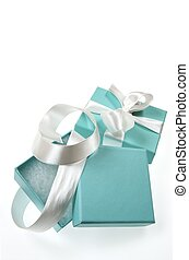luxury gift - two small turquoise box tied with a white...