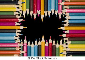 Colour pencils on black background