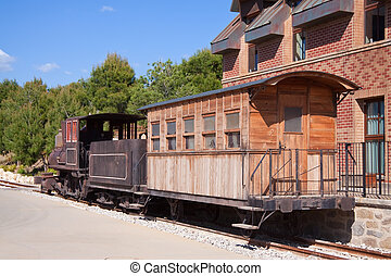 Old steam locomotive with wooden wagon