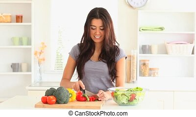 Beautiful woman cooking vegetables