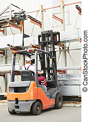 worker driver at warehouse forklift loader works - young...