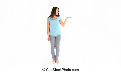 Young woman showing a copy space against a white background